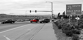 /images/133/2006-10-06-lone-red-jeep-bw.jpg - #02983: red Jeep Wrangler exiting on Lincoln Road… Oct 2006 -- Lincoln Rd, Lone Tree, Colorado