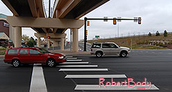 /images/133/2006-10-08-cent-road01.jpg - #03009: red Volvo at I-25 and Dry Creek in Centennial … Oct 2006 -- Centennial, Colorado