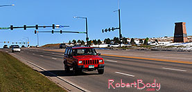 /images/133/2006-10-28-lone-lincoln01.jpg - #03163: red Jeep Cherokee on Lincoln Road … Oct 2006 -- Lincoln Rd, Lone Tree, Colorado