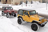 /images/133/2007-01-12-lithia-jeeps02.jpg - #03342: red and yellow Jeep Wranglers at Lithia Jeep … Jan 2007 -- Lithia Jeep, Englewood, Colorado