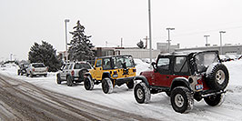 /images/133/2007-01-12-lithia-jeeps05.jpg - #03391: red and yellow Jeep Wranglers at Lithia Jeep … Jan 2007 -- Lithia Jeep, Englewood, Colorado