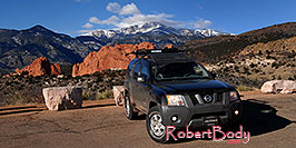 /images/133/2007-02-26-gods-xterra-pano.jpg - #03586: Xterra with Garden of the Gods and Pikes Peak in the background … Feb 2007 -- Garden of the Gods, Colorado Springs, Colorado