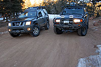 /images/133/2007-02-26-ramp-stuck03.jpg - #03544: Xterra after being rescued by Trigger Land Cruiser … Feb 2007 -- Rampart Range Rd, Colorado Springs, Colorado