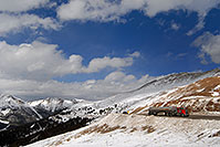 /images/133/2007-04-01-loveland-road02.jpg - #03701: red semi truck approaching top of Loveland Pass from Denver side … April 2007 -- Loveland Pass, Colorado