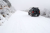/images/133/2007-04-08-rampart-snow-x02.jpg - #03758: Xterra along snowy Rampart Range Road … April 2007 -- Rampart Range Rd, Colorado Springs, Colorado