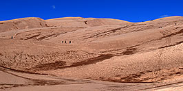 /images/133/2007-04-14-sand-dunes-pan01.jpg - #03784: People walking up Great Sand Dunes … April 2007 -- Great Sand Dunes, Colorado