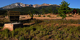 /images/133/2007-06-22-pikes-hut02-pano.jpg - #04032: Crystal Reservoir Visitor Center with Pikes Peak in the background … June 2007 -- Pikes Peak, Colorado
