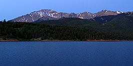 /images/133/2007-06-22-pikes-presun01-pano.jpg - #04042: Pikes Peak at sunrise … a light beacon on the summit … June 2007 -- Crystal Reservoir, Pikes Peak, Colorado