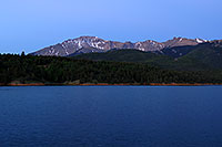 /images/133/2007-06-22-pikes-presun01.jpg - #04041: Pikes Peak at sunrise … a light beacon on the summit … June 2007 -- Crystal Reservoir, Pikes Peak, Colorado
