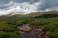 /images/133/2007-07-07-biers-hikers03.jpg - #04198: Hikers crossing Scott Gomer Creek along the trail of Mt Bierstadt … July 2007 -- Scott Gomer Creek, Mt Bierstadt, Colorado