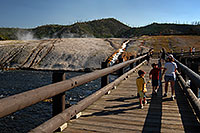 /images/133/2007-07-21-y-mid-bridge01.jpg - #04319: People walking on a bridge over Firehole River towards Excelsior Geyser Crater … July 2007 -- Lower Geyser Basin, Yellowstone, Wyoming