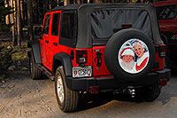 /images/133/2007-07-22-y-canyon-santa.jpg - #04348: Santa`s 2007 red Jeep Wrangler - Santa with white beard on board … July 2007 -- Canyon Village, Yellowstone, Wyoming