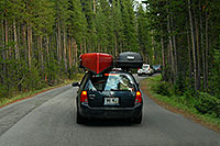 /images/133/2007-07-23-y-inspr-vw.jpg - #04386: VW Jetta with Canoe and Thule cartop - Cars approaching Inspiration Point from Canyon Village -  … July 2007 -- Canyon Village, Yellowstone, Wyoming