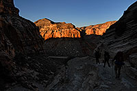 /images/133/2008-04-04-hav-eric-9528.jpg - #05114: Hikers along the first mile of switchbacks of Havasupai Trail at 8 am … April 2008 -- Havasupai Trail, Havasu Falls, Arizona