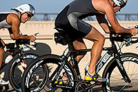 /images/133/2009-09-27-nathan-tri-cycle-114185.jpg - #07473: 01:38:28 - #1145 and #1388 cycling at Nathan Triathlon … September 2009 -- Tempe Town Lake, Tempe, Arizona