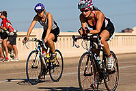 /images/133/2009-09-27-nathan-tri-cycle-114470.jpg - #07472: 01:55:22 - #945 and #1047 cycling at Nathan Triathlon … September 2009 -- Tempe Town Lake, Tempe, Arizona