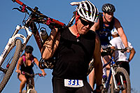 /images/133/2009-10-11-pbr-off-tri-bike-115551.jpg - #07559: 01:03:39 mountain bikers dismounting or not at a steep downhill - PBR Offroad Triathlon, Oct 11, 2009 … October 2009 -- Papago Park, Tempe, Arizona