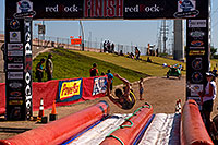 /images/133/2009-10-11-pbr-off-tri-bike-115882.jpg - #07567: 02:54:23 Finisher on a water slide - PBR Offroad Triathlon, Oct 11, 2009 at Tempe Town Lake … October 2009 -- Tempe Town Lake, Tempe, Arizona