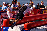 /images/133/2009-10-11-pbr-off-tri-run-115838.jpg - #07571: 02:44:35 Runner finishing on a water slide - PBR Offroad Triathlon, Oct 11, 2009 at Tempe Town Lake … October 2009 -- Tempe Town Lake, Tempe, Arizona