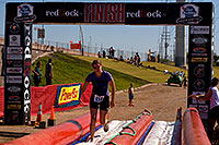 /images/133/2009-10-11-pbr-off-tri-run-115891.jpg - #07572: 02:54:42 Runner finishing on a water slide - PBR Offroad Triathlon, Oct 11, 2009 at Tempe Town Lake … October 2009 -- Tempe Town Lake, Tempe, Arizona