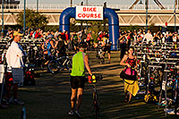 /images/133/2009-10-25-soma-transition-118169.jpg - #07735: 00:48:02 Swimmers transitions to bikes at Soma Triathlon … October 25, 2009 -- Tempe Town Lake, Tempe, Arizona