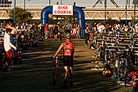 /images/133/2009-10-25-soma-transition-118198.jpg - #07736: 00:49:50 Swimmers transitions to bikes at Soma Triathlon … October 25, 2009 -- Tempe Town Lake, Tempe, Arizona