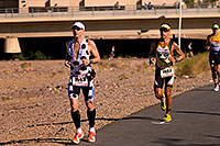 /images/133/2009-11-22-ironman-run-126709.jpg - #07977: 07:09:43 #1143 and #1667 running - Ironman Arizona 2009 … November 2009 -- Tempe Town Lake, Tempe, Arizona