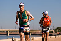 /images/133/2009-11-22-ironman-run-126759.jpg - #07983: 07:39:07 #298 and #1989 running - Ironman Arizona 2009 … November 2009 -- Tempe Town Lake, Tempe, Arizona
