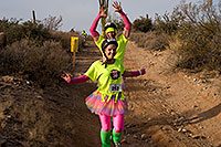 /images/133/2009-12-13-muddy-buddy-129504.jpg - #08049: Couple in skirts at Muddy Buddy Race 2009 … Dec 13, 2009 -- McDowell Mountain Park, Fountain Hills, Arizona