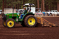/images/133/2010-07-10-flag-naha-tractor-12458.jpg - #08280: Preparing the field for NAHA event in Flagstaff … July 2010 -- Fort Tuthill County Park, Flagstaff, Arizona