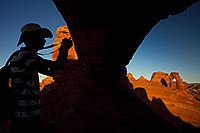 /images/133/2010-09-05-arches-delicate-wind-31693.jpg - #08647: Photographer silhouette and view of Delicate Arch in Arches National Park … September 2010 -- Delicate Arch, Arches Park, Utah