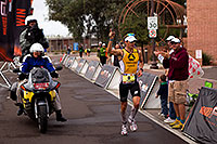 /images/133/2010-11-21-ironman-finish-45871.jpg - #08964: 08:06:21 - #9 Timo Bracht [1st,GER,08:07:16] finishing first - Ironman Arizona 2010 … November 2010 -- Rio Salado Parkway, Tempe, Arizona