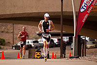 /images/133/2010-11-21-ironman-run-pros-45778.jpg - #09013: 03:48:55 - #1 Jordan Rapp early in Lap 3 - Ironman Arizona 2010 … November 2010 -- Tempe Town Lake, Tempe, Arizona