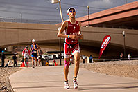 /images/133/2010-11-21-ironman-run-pros-45824.jpg - #09017: 04:54:11 - #1 Jordan Rapp holding second place on Lap 2 - Ironman Arizona 2010 … November 2010 -- Tempe Town Lake, Tempe, Arizona