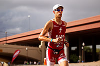 /images/133/2010-11-21-ironman-run-pros-45828.jpg - #09018: 04:54:13 - #1 Jordan Rapp holding second place on Lap 2 - Ironman Arizona 2010 … November 2010 -- Tempe Town Lake, Tempe, Arizona