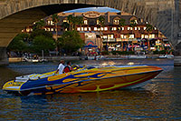 /images/133/2011-04-02-havasu-bridge-evening-65783.jpg - #09213: Boat at London Bridge in Lake Havasu City … April 2011 -- London Bridge, Lake Havasu City, Arizona