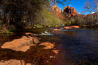 /images/133/2011-04-10-sedona-cat-river-66395.jpg - #09225: People jumping across rocks by Cathedral Rock and Oak Creek in Sedona … April 2011 -- Cathedral Rock, Sedona, Arizona