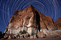 /images/133/2011-07-10-powell-startrails-82048m.jpg - #09381: 3.5 hours of star trails above a rock at Lake Powell … July 2011 -- Lake Powell, Arizona