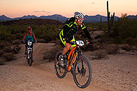 /images/133/2011-11-05-trek-fury-110794.jpg - #09744: 07:28:03 #76 and #24 at the end of the lap of Mountain Biking at Trek Bicycles 12 and 24 Hours of Fury … Nov 5-6, 2011 -- McDowell Mountain Park, Fountain Hills, Arizona