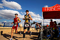 /images/133/2011-11-20-ironman-run-123842.jpg - #09850: 07:33:16 - #1322 and #1004 running in Ironman Arizona 2011 … November 2011 -- Tempe, Arizona