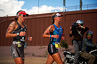 /images/133/2011-11-20-ironman-run-pros-d3s-2625.jpg - #09881: 06:31:01 - #72 Meredith Kessler [USA] (eventual 4th) and #73 Amanda Stevens [USA] (eventual 5th, 9 minutes later) in Lap 1 - Ironman Arizona 2011 … November 2011 -- Tempe, Arizona