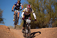 /images/133/2012-01-07-papago-bikes-jumps-135004.jpg - #09917: 04:21:27 #62 jumping behind #213 at 12 Hours of Papago 2012 … January 7, 2012 -- Papago Park, Tempe, Arizona