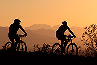 /images/133/2012-01-07-papago-bikes-sunset-136605.jpg - #10037: 10:08:09 #411 and #241 mountain biking at sunset at 12 Hours of Papago 2012 … January 7, 2012 -- Papago Park, Tempe, Arizona