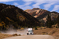 /images/133/2015-09-21-silverton-fedex-6d_9138.jpg - #12682: FedEx truck approaching Silverton on a dirt road … September 2015 -- Silverton, Colorado