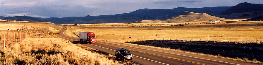 /images/500/2004-10-yaks-landscape-sp.jpg - #02353: red semi truck heading to Gunnison in the late October afternoon … Yaks to the right  … October 2004 -- Sargeants, Colorado